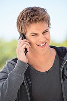 Close_up of a man talking on a mobile phone and smiling
