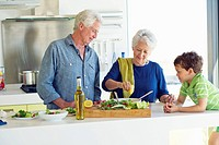 Senior couple with their grandson at a kitchen counter