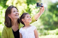 Woman and her granddaughter taking photos of themselves