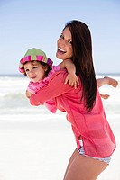 Woman enjoying on the beach with her daughter (thumbnail)