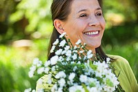 Woman holding a bunch of flowers outdoors