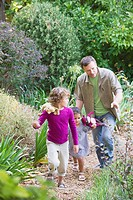Father with two children walking in a garden (thumbnail)