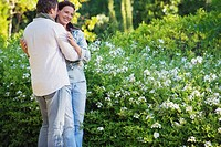 Happy mature couple romancing in a garden