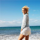 Portrait of pretty young blond woman on Maui, Hawaii beach smiling.