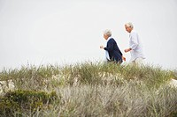 Senior couple running on the beach