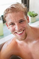 Portrait of a man smiling in a bathtub