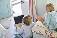 Children using electronic gadgets at home