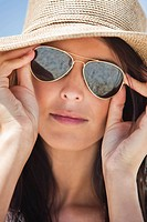 Close_up of a woman wearing sunglasses