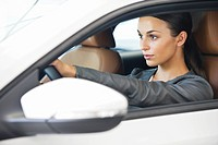 Beautiful young woman taking a test drive
