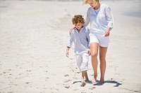 Woman walking with her son on the beach