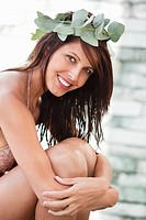 Portrait of a woman smiling with leaves crown