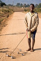 A young African boy playing with his toy car, Mbabane, Swaziland