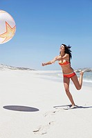 Woman playing with beach ball