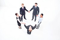 Five businesspeople standing together hand in hand