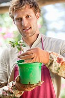 Portrait of a man gardening and smiling