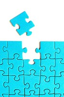 A jigsaw piece is the last piece of the blue puzzle. Concept