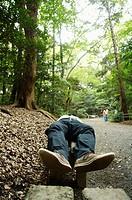 Man sleeping in park, Tokyo, Japan