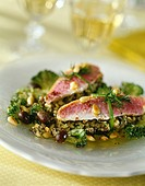 Red mullet fillets with pesto and pine nuts
