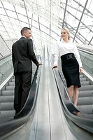 businesswoman and man meeting on escalator