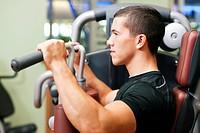 Man in gym exercising
