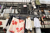 Shanghai (China): laundry drying on a electricity pole in Huangpu