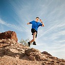 USA, Arizona, Phoenix, Mid adult man jogging on desert