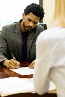 Professional man completing application at job interview