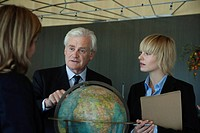 Executive outlining future plans of global business to colleagues