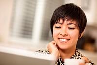 Pretty Smiling Multiethnic Woman Using Laptop