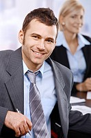 Smiling businessman at meeting