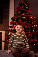 Little boy in front of Christmas tree