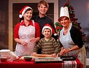 Family of four preparing for Christmas