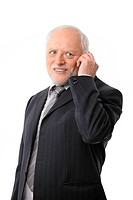 Happy senior businessman on the phone