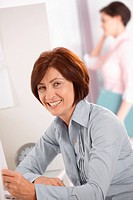 Smiling mature female office worker