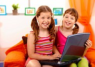 Girls having fun with laptop