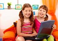 Girls having fun with laptop