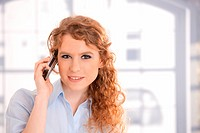 Portrait of attractive woman using mobile phone