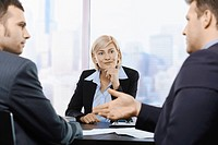Businesswoman concentrating at meeting