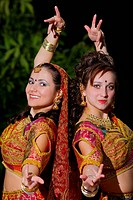 two young woman dance _ indian cloth