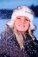 beautiful young woman in snowy winter