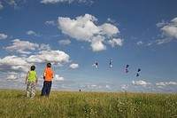 Two boys watching kites in the sky, Teufelsberg, Berlin, Germany