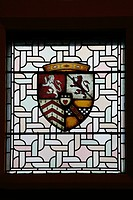 Stained glass window with coats of arm