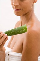 Young woman with Aloe Vera, Munich, Bavaria, Germany