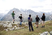 Five hikers enjoying the view on mountain peak, Austria