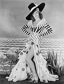 Woman posing in striped and polkadot costume