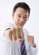 Businessman punching