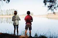 Children standing by lake