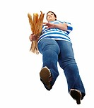 Large woman carrying baguettes