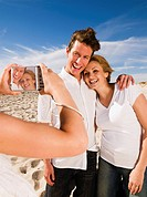 Couple having picture taken on beach