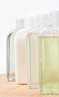 Close up of four massage oil bottles